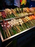 Еды и овощи зажаренные с перцем Сычуань были известно приправлять Xishuangba Стоковое Фото