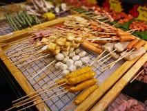 Еды и овощи зажаренные с перцем Сычуань были известно приправлять Xishuangba Стоковое Изображение