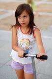 ее самокат riding Стоковое Изображение
