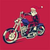 Езда Санта Клауса велосипед тяпки Стоковая Фотография