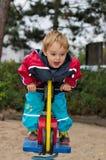 езда спортивной площадки мальчика Стоковое Изображение
