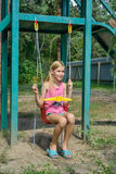 Езда девушки на качании Стоковая Фотография RF
