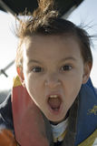 езда мальчика шлюпки Стоковое Изображение