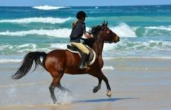 Езда пляжа Стоковые Изображения