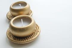 2 декоративных свечи в цвете золота Стоковые Фото