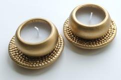 2 декоративных свечи в цвете золота Стоковое фото RF