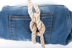 демикотон предпосылки голубой голубая текстура джинсыов джинсовой ткани заднее карманн джинсыов предпосылки Стоковые Фото