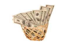100 денег долларовых банкнот в корзине Стоковые Изображения