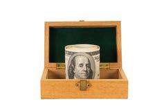 100 денег долларовых банкнот в коробке Стоковое фото RF