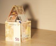 деньги дома владельцев дома цен принципиальной схемы заработанные изображением представляют Стоковое фото RF