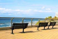 3 деревянной скамьи в парке Стоковые Изображения RF