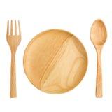 деревянные вилки плиты и ложек на белой предпосылке Стоковое фото RF