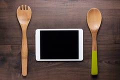 2 деревянных ложки и планшета Стоковые Изображения RF