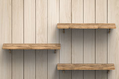3 деревянных полки на стене Стоковые Фото