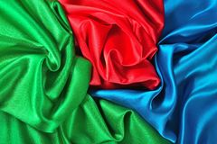 Естественная голубая, красная и зеленая текстура ткани сатинировки Стоковые Изображения