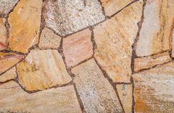 Естественная желтая текстура камня мостоваой для пола, стены или пути Стоковые Фотографии RF