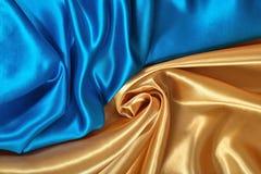 Естественная золотая и голубая текстура ткани сатинировки Стоковое Фото