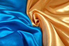 Естественная золотая и голубая текстура ткани сатинировки Стоковые Изображения RF