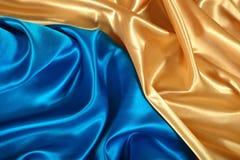 Естественная золотая и голубая текстура ткани сатинировки Стоковые Изображения