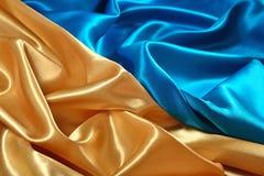 Естественная золотая и голубая текстура ткани сатинировки Стоковая Фотография