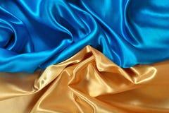 Естественная золотая и голубая текстура ткани сатинировки Стоковая Фотография RF