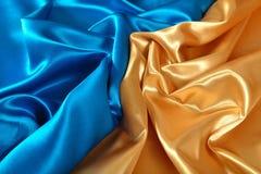 Естественная золотая и голубая текстура ткани сатинировки Стоковое Изображение RF