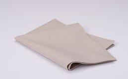 Естественная Linen салфетка на белой предпосылке Стоковое Изображение RF