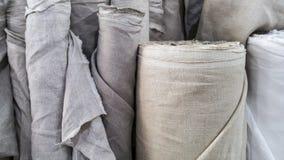 Естественная linen ткань в крене Стоковая Фотография
