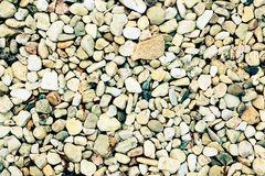 Естественная pabble предпосылка с винтажным взглядом Стоковая Фотография