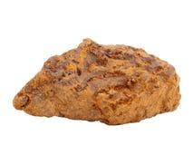 Естественный образец лимонита - одной из важных железных руд коричневой руды или руды и пигмента трясины охра желтая на белой пре Стоковые Фото