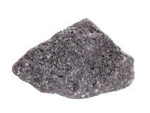 Естественный образец минерала хромита, самая важная руда хромия на белой предпосылке стоковая фотография