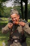 ест свинину nazi ноги стоковая фотография