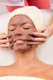 детеныши женщины маски глины лицевые Стоковое Изображение RF