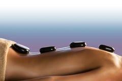 детеныши женщины терапией руки каменные стоковая фотография rf