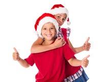 2 дет в шляпах рождества совместно Стоковое Фото