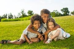 3 дет играют на glade Стоковые Изображения