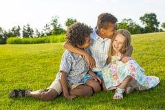 3 дет играют на glade Стоковая Фотография RF