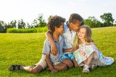 3 дет играют на glade Стоковые Фотографии RF