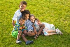 4 дет играют на glade Стоковая Фотография RF