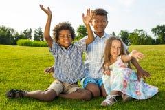 3 дет играют на glade Стоковые Фото
