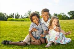 3 дет играют Стоковые Фото