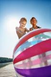 2 дет на озере с шариком пляжа Стоковое фото RF