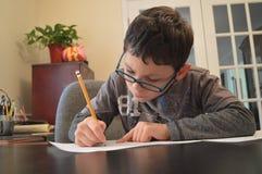 делать школьника домашней работы Стоковое Фото