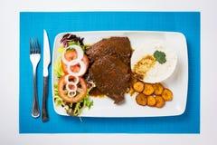Еда венесуэльца негра Asado типичная Стоковые Фотографии RF