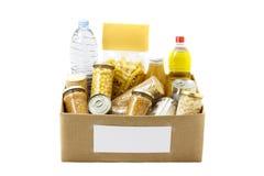 Еда в коробке пожертвования стоковое фото rf