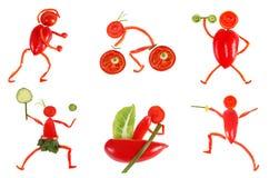еда здоровая Маленькие смешные люди сделанные из овощей и плодоовощ Стоковое Фото