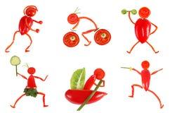 еда здоровая Маленькие смешные люди сделанные из овощей и плодоовощ Стоковое Изображение