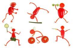 еда здоровая Маленькие смешные люди сделанные из овощей и плодоовощ Стоковая Фотография