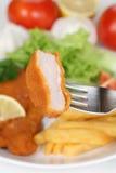 Еда котлеты отбивной котлеты шницеля сосиски с вилкой Стоковая Фотография RF
