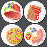 Еда на плитах Стоковое Изображение